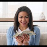 woman holding lots of money in hand